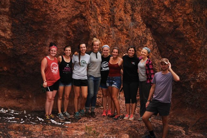 This is some of my classmates and I at The Cliffs! We climbed down to stand under some caves!