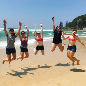Students jumping at Burleigh beach