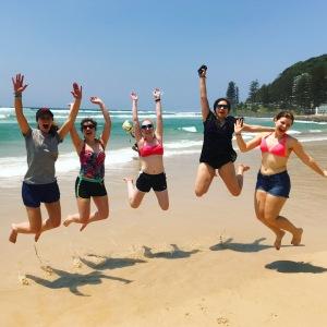Students jumping at Burleigh beach